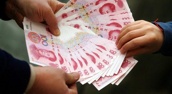 Tiền Trung Quốc đổi ra tiền Việt Nam được thực hiện như thế nào?